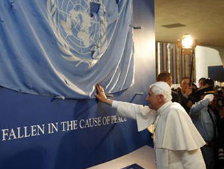 His Holiness Pope Benedict XVI touches the United Nations flag removed from the ruins of the United Nations Headquarters in Baghdad during the 2001 bombing attack, in remembrance of the injured and those who died.